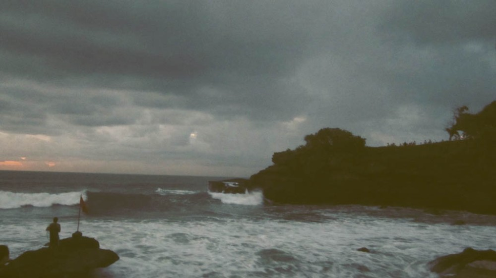 The scene when it's starting to get dark and waves come crashing towards the cliff.
